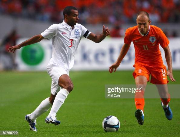 Arjen Robben of Netherlands battle with Ashley Cole of England during the International Friendly between Netherlands and England at the Amsterdam...