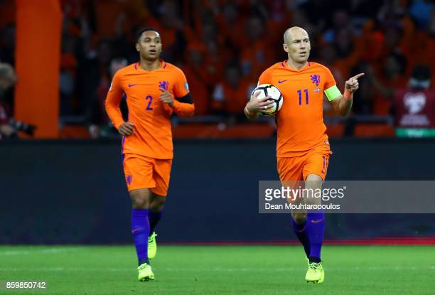 Arjen Robben of Netherlands celebrates scoring the 1st goal with Kenny Tete of Netherlands during the FIFA 2018 World Cup Qualifier between...