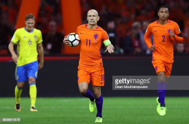 Arjen Robben of Netherlands celebrates scoring the 1st goal with Kenny Tete of Netherlands as Ludwig Augustinsson of Sweden looks dejected during the...