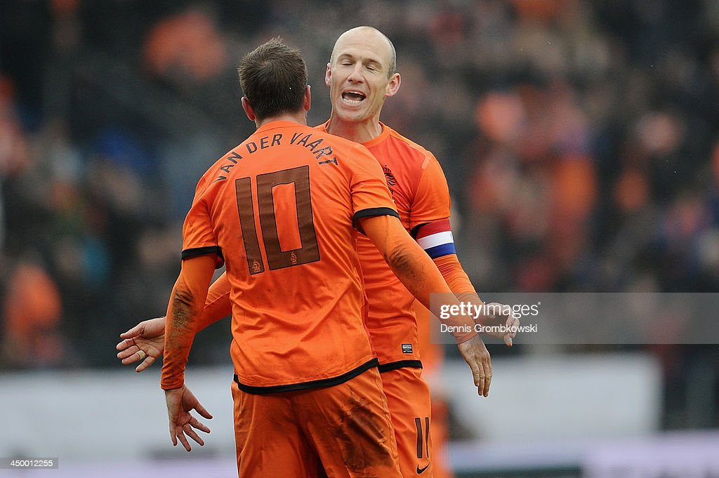 <a gi-track='captionPersonalityLinkClicked' href=/galleries/search?phrase=Arjen+Robben&family=editorial&specificpeople=194740 ng-click='$event.stopPropagation()'>Arjen Robben</a> of Netherlands celebrates the second goal with teammate <a gi-track='captionPersonalityLinkClicked' href=/galleries/search?phrase=Rafael+van+der+Vaart&family=editorial&specificpeople=210815 ng-click='$event.stopPropagation()'>Rafael van der Vaart</a> during the International Friendly match between the Netherlands and Japan on November 16, 2013 in Genk, Belgium.