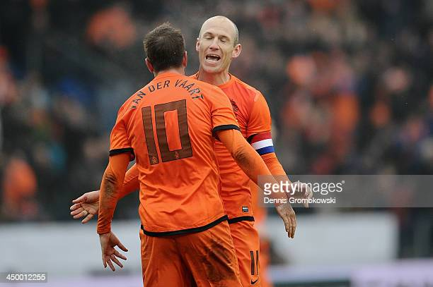 Arjen Robben of Netherlands celebrates the second goal with teammate Rafael van der Vaart during the International Friendly match between the...