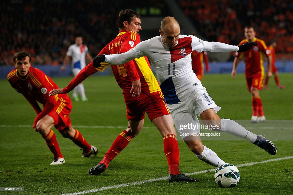 Arjen Robben of Netherlands gets past Gabriel Tamas of Romania during the the Group 4 FIFA 2014 World Cup Qualifier match between Netherlands and Romania at Amsterdam Arena on March 26, 2013 in Amsterdam, Netherlands.