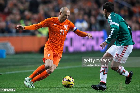 Arjen Robben of Netherlands runs at Adrian Aldrete of Mexico during the international friendly match between Netherlands and Mexico held at the...