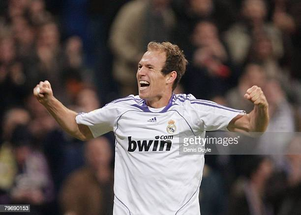 Arjen Robben of Real Madrid celebrates after scoring Real's third goal during the La Liga match between Real Madrid and Valladolid at the Santiago...