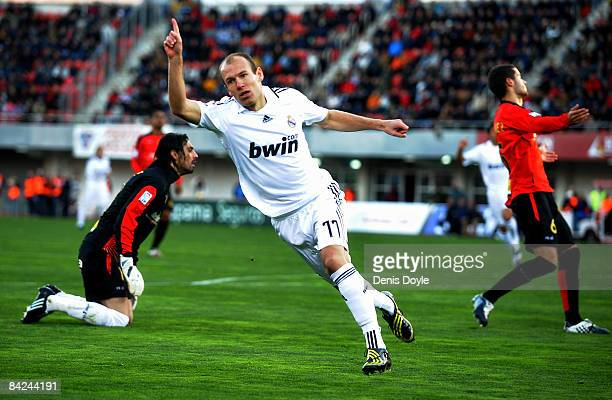 Arjen Robben of Real Madrid celerates after scoring their first goal during the La Liga match betwen Mallorca and Real Madrid at the San Moix stadium...