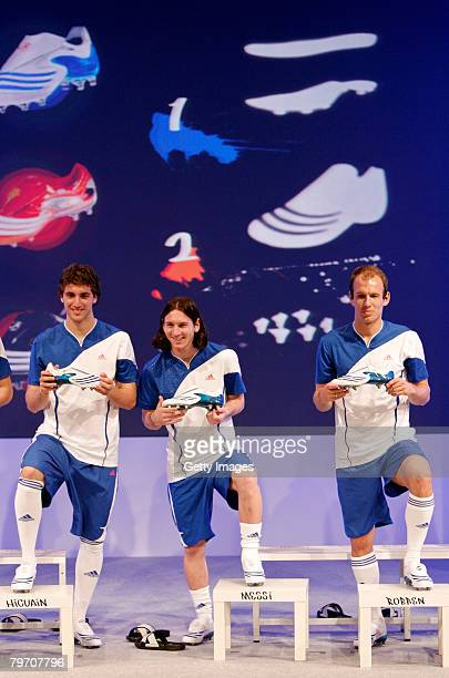 Arjen Robben of Real Madrid Lionel Messi from Barcelona and Gonzalo Higuain also of Real Madrid pose during the adidas F50 TUNiT football boot launch...