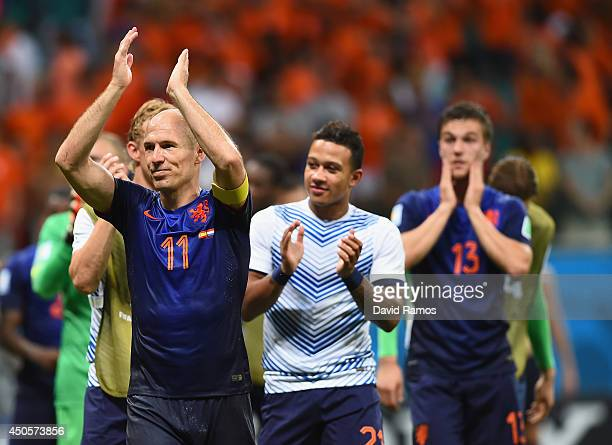 Arjen Robben of the Netherlands acknowleges the fans after defeating the Netherlands in the 2014 FIFA World Cup Brazil Group B match between Spain...
