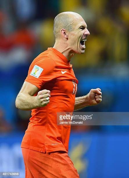 Arjen Robben of the Netherlands celebrates after defeating Costa Rica in a penalty shootout during the 2014 FIFA World Cup Brazil Quarter Final match...