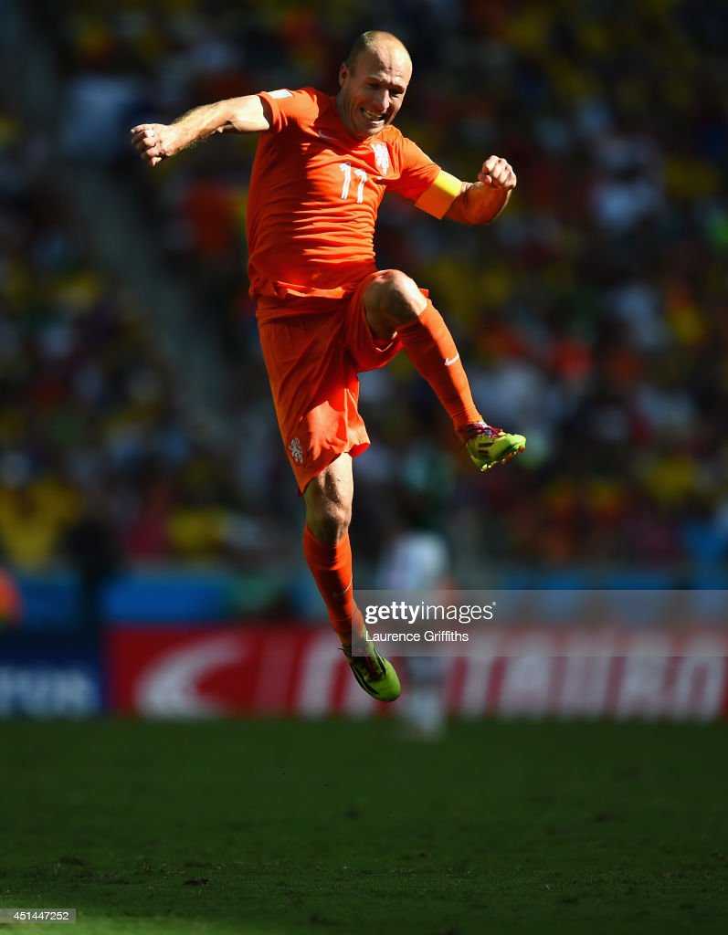 <a gi-track='captionPersonalityLinkClicked' href=/galleries/search?phrase=Arjen+Robben&family=editorial&specificpeople=194740 ng-click='$event.stopPropagation()'>Arjen Robben</a> of the Netherlands celebrates after defeating Mexico 2-1 during the 2014 FIFA World Cup Brazil Round of 16 match between Netherlands and Mexico at Castelao on June 29, 2014 in Fortaleza, Brazil.