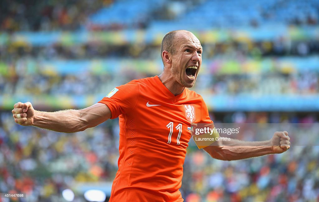 Arjen Robben of the Netherlands celebrates after defeating Mexico 21 during the 2014 FIFA World Cup Brazil Round of 16 match between Netherlands and...