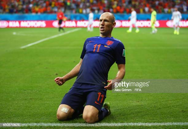 Arjen Robben of the Netherlands celebrates after scoring a goal during the 2014 FIFA World Cup Brazil Group B match between Spain and Netherlands at...
