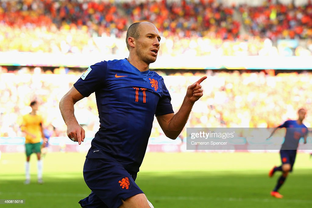 <a gi-track='captionPersonalityLinkClicked' href=/galleries/search?phrase=Arjen+Robben&family=editorial&specificpeople=194740 ng-click='$event.stopPropagation()'>Arjen Robben</a> of the Netherlands celebrates after scoring his team's first goal during the 2014 FIFA World Cup Brazil Group B match between Australia and Netherlands at Estadio Beira-Rio on June 18, 2014 in Porto Alegre, Brazil.