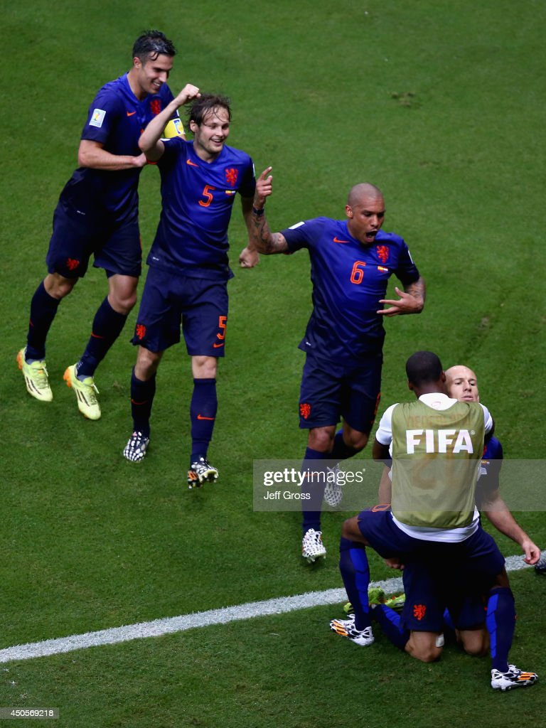 <a gi-track='captionPersonalityLinkClicked' href=/galleries/search?phrase=Arjen+Robben&family=editorial&specificpeople=194740 ng-click='$event.stopPropagation()'>Arjen Robben</a> of the Netherlands celebrates his teams second goal with Robin van Persie (L), <a gi-track='captionPersonalityLinkClicked' href=/galleries/search?phrase=Daley+Blind&family=editorial&specificpeople=5566498 ng-click='$event.stopPropagation()'>Daley Blind</a> (2nd L) and Nigel de Jong (C) during the 2014 FIFA World Cup Brazil Group B match between Spain and Netherlands at Arena Fonte Nova on June 13, 2014 in Salvador, Brazil.
