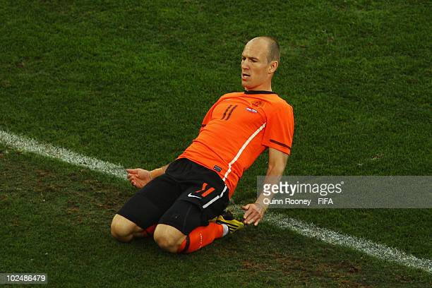 Arjen Robben of the Netherlands celebrates scoring the opening goal during the 2010 FIFA World Cup South Africa Round of Sixteen match between...