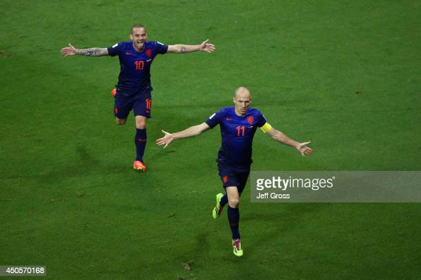 Arjen Robben of the Netherlands celebrates scoring the team's fifth goal with Wesley Sneijder during the 2014 FIFA World Cup Brazil Group B match...