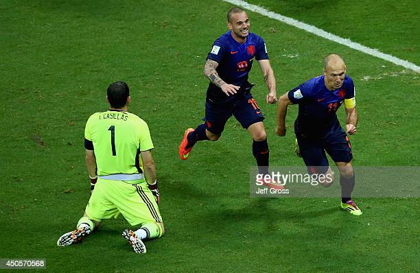 Arjen Robben of the Netherlands celebrates scoring the team's fifth goal with Wesley Sneijder as goalkeeper Iker Casillas of Spain looks on during...