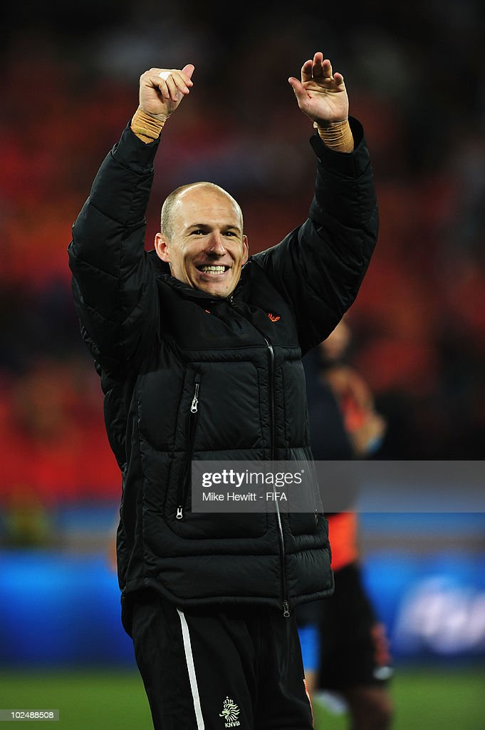 <a gi-track='captionPersonalityLinkClicked' href=/galleries/search?phrase=Arjen+Robben&family=editorial&specificpeople=194740 ng-click='$event.stopPropagation()'>Arjen Robben</a> of the Netherlands celebrates victory and progress to the quarter finals after the 2010 FIFA World Cup South Africa Round of Sixteen match between Netherlands and Slovakia at Durban Stadium on June 28, 2010 in Durban, South Africa.