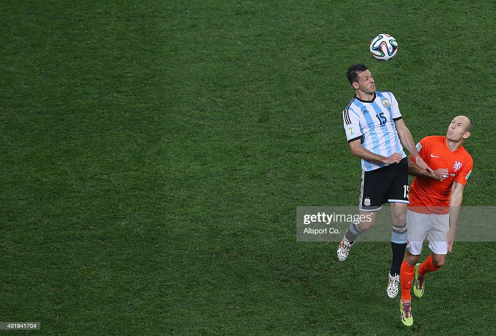 Arjen Robben of the Netherlands competes Martin Demichelis of Argentina during the 2014 FIFA World Cup Brazil Semi Final match between the Netherlands and Argentina at Arena de Sao Paulo on July 9, 2014 in Sao Paulo, Brazil.