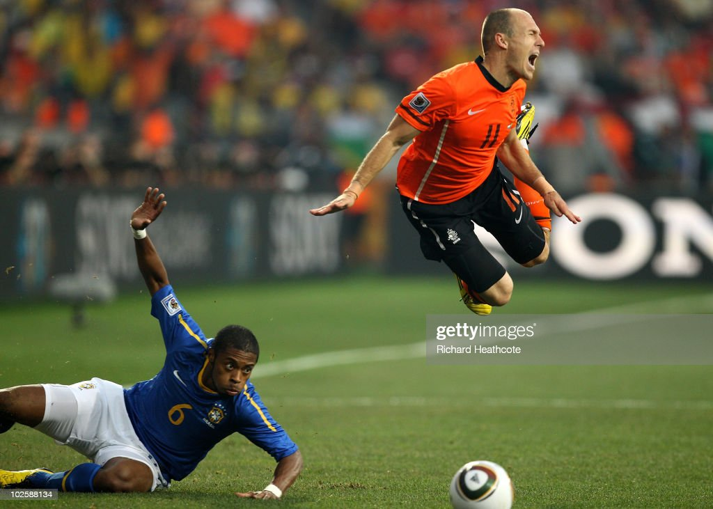 <a gi-track='captionPersonalityLinkClicked' href=/galleries/search?phrase=Arjen+Robben&family=editorial&specificpeople=194740 ng-click='$event.stopPropagation()'>Arjen Robben</a> of The Netherlands dives over the tackle of <a gi-track='captionPersonalityLinkClicked' href=/galleries/search?phrase=Michel+Bastos&family=editorial&specificpeople=1549621 ng-click='$event.stopPropagation()'>Michel Bastos</a> of Brazil during the 2010 FIFA World Cup South Africa Quarter Final match between Netherlands and Brazil at Nelson Mandela Bay Stadium on July 2, 2010 in Nelson Mandela Bay/Port Elizabeth, South Africa.