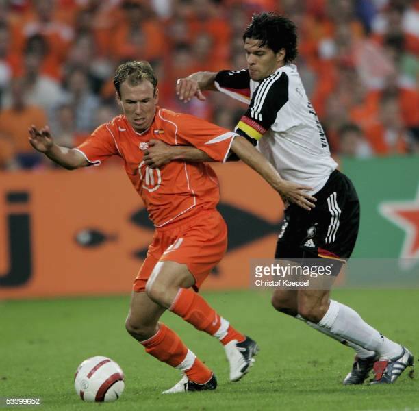 Arjen Robben of the Netherlands is tackled by Michael Ballack of Germany during the international friendly match between Netherlands and Germany at...