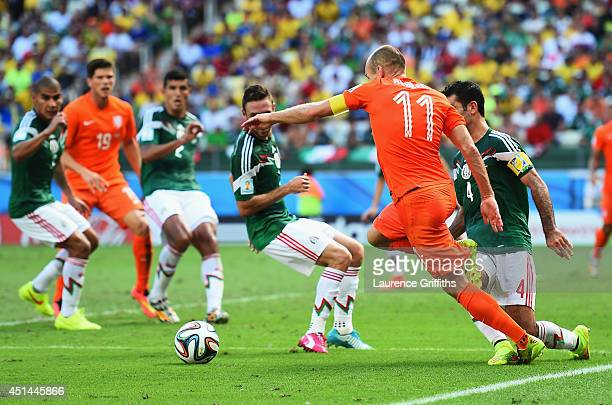 Arjen Robben of the Netherlands is tripped by Rafael Marquez of Mexico for a penalty during the 2014 FIFA World Cup Brazil Round of 16 match between...