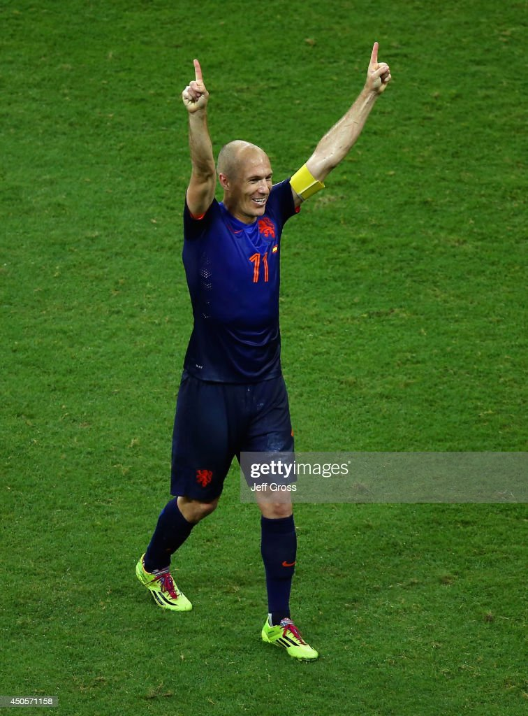 <a gi-track='captionPersonalityLinkClicked' href=/galleries/search?phrase=Arjen+Robben&family=editorial&specificpeople=194740 ng-click='$event.stopPropagation()'>Arjen Robben</a> of the Netherlands reacts after defeating Spain 5-1 during the 2014 FIFA World Cup Brazil Group B match between Spain and Netherlands at Arena Fonte Nova on June 13, 2014 in Salvador, Brazil.