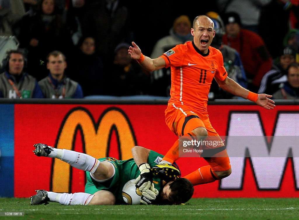 <a gi-track='captionPersonalityLinkClicked' href=/galleries/search?phrase=Arjen+Robben&family=editorial&specificpeople=194740 ng-click='$event.stopPropagation()'>Arjen Robben</a> of the Netherlands reacts to the referee as <a gi-track='captionPersonalityLinkClicked' href=/galleries/search?phrase=Iker+Casillas&family=editorial&specificpeople=215446 ng-click='$event.stopPropagation()'>Iker Casillas</a> of Spain collects the ball during the 2010 FIFA World Cup South Africa Final match between Netherlands and Spain at Soccer City Stadium on July 11, 2010 in Johannesburg, South Africa.