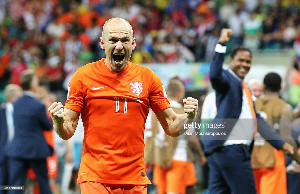 <a gi-track='captionPersonalityLinkClicked' href=/galleries/search?phrase=Arjen+Robben&family=editorial&specificpeople=194740 ng-click='$event.stopPropagation()'>Arjen Robben</a> of the Netherlands screams as he celebrates victory after the 2014 FIFA World Cup Brazil Quarter Final match between the Netherlands and Costa Rica at Arena Fonte Nova on July 5, 2014 in Salvador, Brazil.