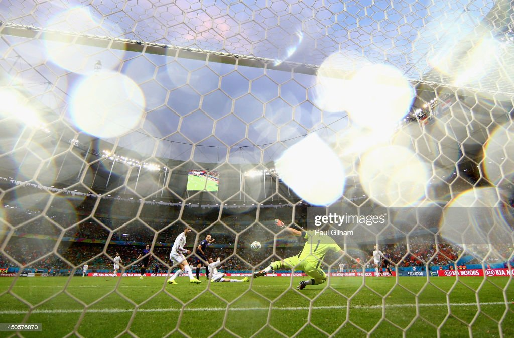 Arjen Robben of the Netherlands shoots and scores the team's second goal against Iker Casillas of Spain during the 2014 FIFA World Cup Brazil Group B match between Spain and Netherlands at Arena Fonte Nova on June 13, 2014 in Salvador, Brazil.