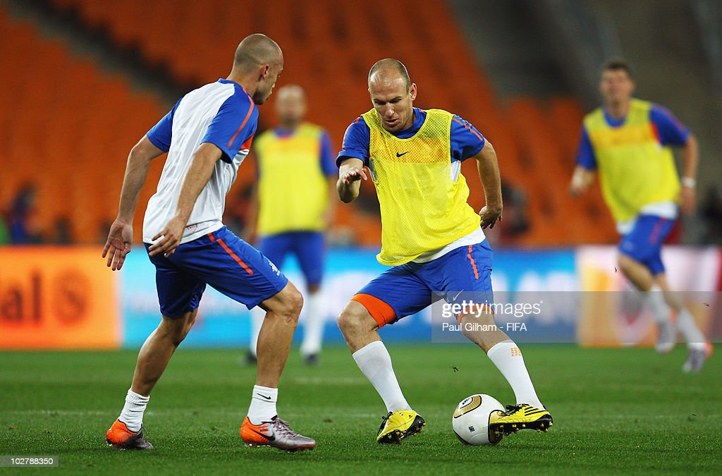 Arjen Robben (R) of the Netherlands takes on team mate Johnny Heitinga during a Netherlands training session, ahead of the 2010 FIFA World Cup Final, at Soccer City Stadium on July 10, 2010 in Johannesburg, South Africa.