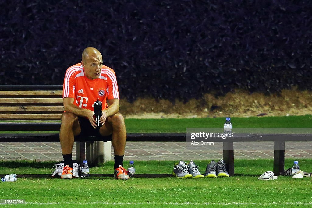 <a gi-track='captionPersonalityLinkClicked' href=/galleries/search?phrase=Arjen+Robben&family=editorial&specificpeople=194740 ng-click='$event.stopPropagation()'>Arjen Robben</a> pauses during a Bayern Muenchen training session at the ASPIRE Academy for Sports Excellence on January 2, 2013 in Doha, Qatar.