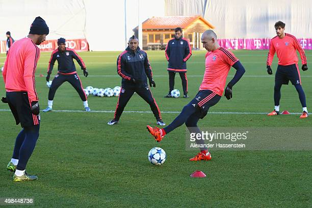 Arjen Robben plays the ball during a FC Bayern Muenchen training session on the eve of their UEFA Champions League match against Olympiacos FC at...