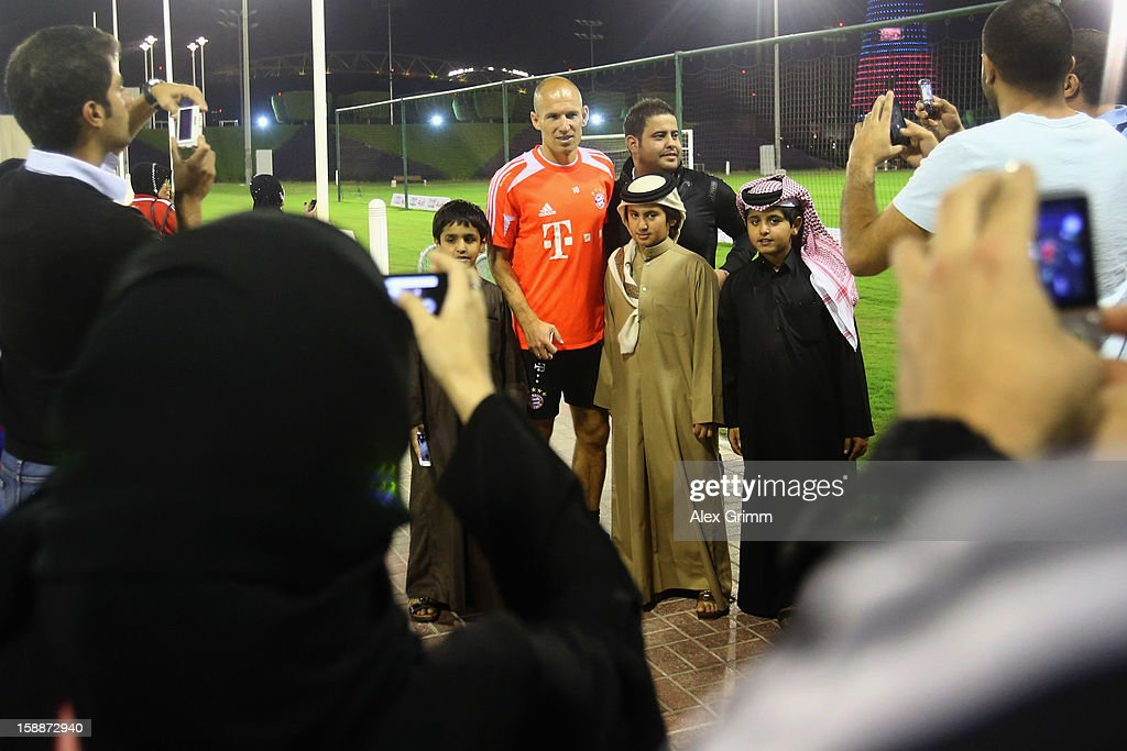 <a gi-track='captionPersonalityLinkClicked' href=/galleries/search?phrase=Arjen+Robben&family=editorial&specificpeople=194740 ng-click='$event.stopPropagation()'>Arjen Robben</a> poses for fans during a Bayern Muenchen training session at the ASPIRE Academy for Sports Excellence on January 2, 2013 in Doha, Qatar.