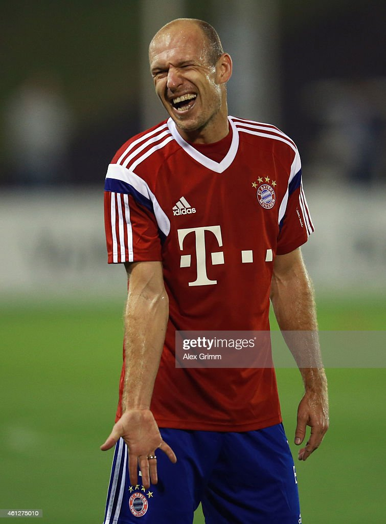 <a gi-track='captionPersonalityLinkClicked' href=/galleries/search?phrase=Arjen+Robben&family=editorial&specificpeople=194740 ng-click='$event.stopPropagation()'>Arjen Robben</a> reacts during day 2 of the Bayern Muenchen training camp at ASPIRE Academy for Sports Excellence on January 10, 2015 in Doha, Qatar.
