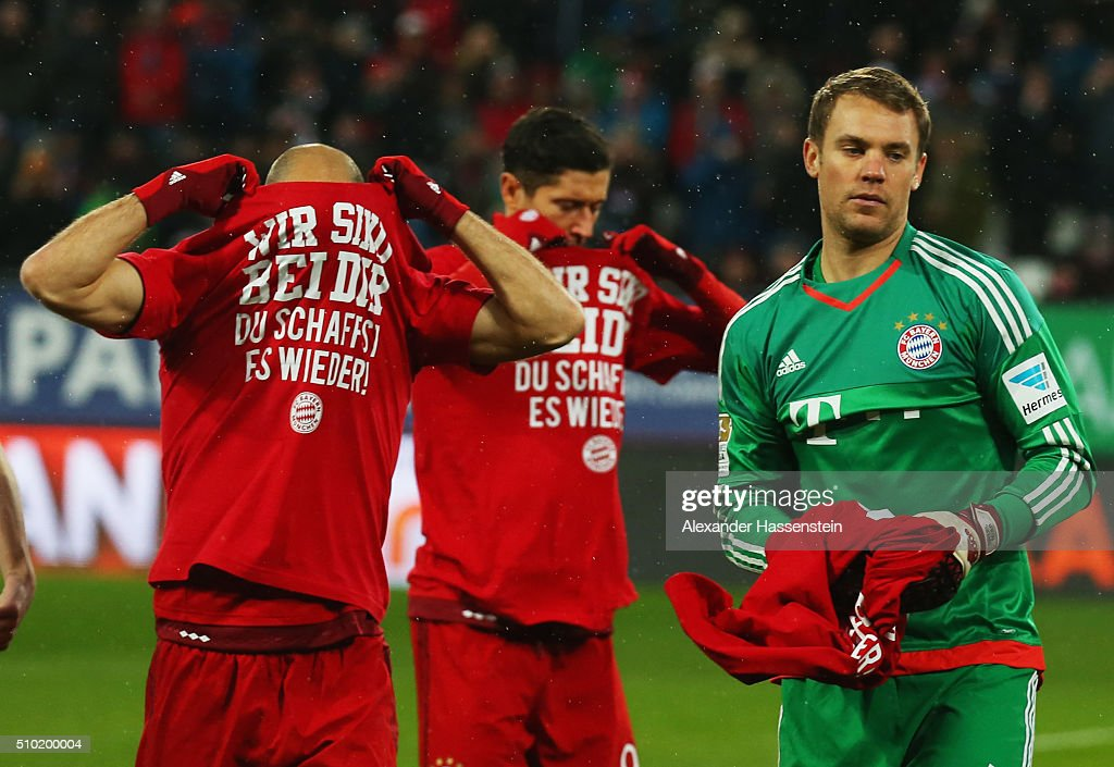 <a gi-track='captionPersonalityLinkClicked' href=/galleries/search?phrase=Arjen+Robben&family=editorial&specificpeople=194740 ng-click='$event.stopPropagation()'>Arjen Robben</a>, <a gi-track='captionPersonalityLinkClicked' href=/galleries/search?phrase=Robert+Lewandowski&family=editorial&specificpeople=5532633 ng-click='$event.stopPropagation()'>Robert Lewandowski</a> and <a gi-track='captionPersonalityLinkClicked' href=/galleries/search?phrase=Manuel+Neuer&family=editorial&specificpeople=764621 ng-click='$event.stopPropagation()'>Manuel Neuer</a> of Bayern Munich remove t-shirts showing support for injured team mate Holger Badstuber as they line up prior the Bundesliga match between FC Augsburg and FC Bayern Muenchen at SGL Arena on February 14, 2016 in Augsburg, Germany.