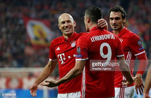Arjen Robben Robert Lewandowski and Mats Hummels of Munich celebrate a goal during the Champions League soccer match between Bayern Munich and PSV...