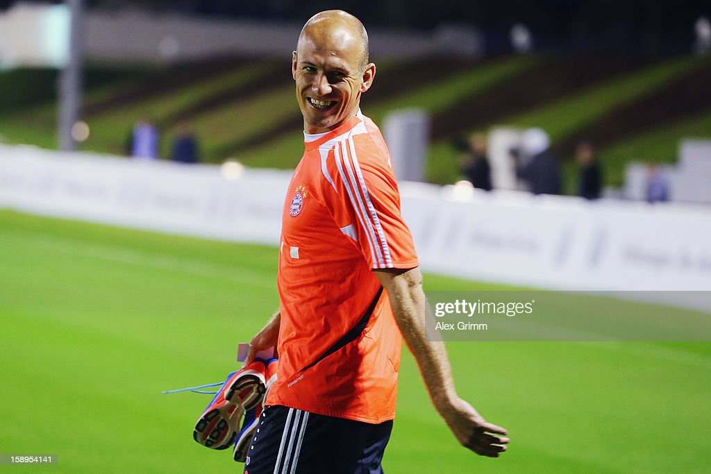 <a gi-track='captionPersonalityLinkClicked' href=/galleries/search?phrase=Arjen+Robben&family=editorial&specificpeople=194740 ng-click='$event.stopPropagation()'>Arjen Robben</a> smiles on his way to a Bayern Muenchen training session at the ASPIRE Academy for Sports Excellence on January 4, 2013 in Doha, Qatar.