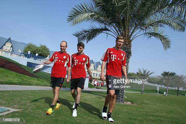 Arjen Robben Thomas Mueller and Holger Badstuber arrive for a training session of Bayern Muenchen at the ASPIRE Academy for Sports Excellence on...