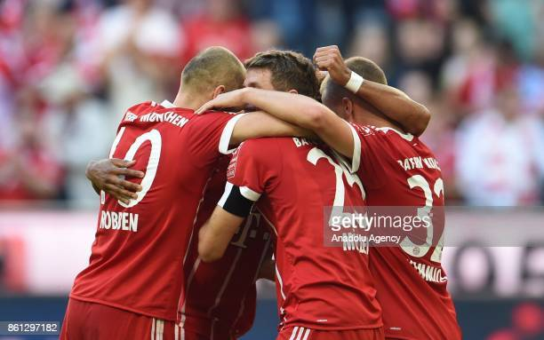 Arjen Robben Thomas Mueller and Joshua Kimmich of FC Bayern Munich celebrate after scoring a goal during the Bundesliga soccer match between FC...