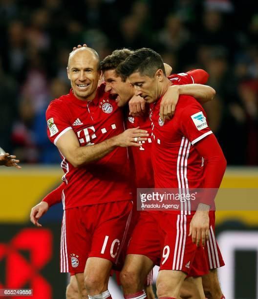Arjen Robben Thomas Mueller and Robert Lewandowski of Bayern Munich celebrate scoring a goal during the Bundesliga Match between Borussia...