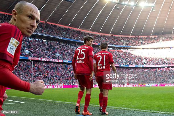 Arjen Robben Thomas Muller and Philipp Lahm of Muenchen enters the field for the Bundesliga match between FC Bayern Muenchen and 1 FC Koeln at...