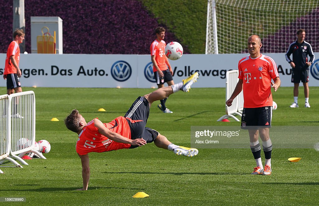 Arjen Robben watches Bastian Schweinsteiger perform a bicycle-kick during a Bayern Muenchen training session at the ASPIRE Academy for Sports Excellence on January 6, 2013 in Doha, Qatar.