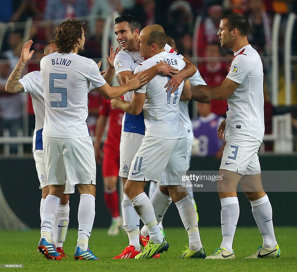 Arjen Roben of Netherlands celebrates his goal against Turkey as he hugs Ron Vlaar during FIFA 2014 World Cup Qualifier match at the Sukru Saracoglu Stadium on October 15, 2013 in Istanbul, Turkey.