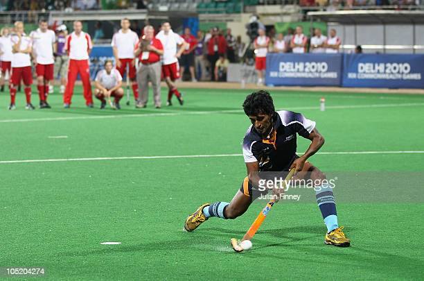 Arjun Halappa of India scores a controversial goal in the penalty shoot out during the semi final hockey match between India and England at Major...