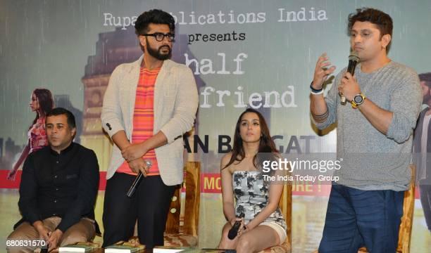 Arjun Kapoor Shraddha Kapoor Mohit Suri and Chetan Bhagat during the launch of Chetan Bhagats book Half Girlfriend in Mumbai