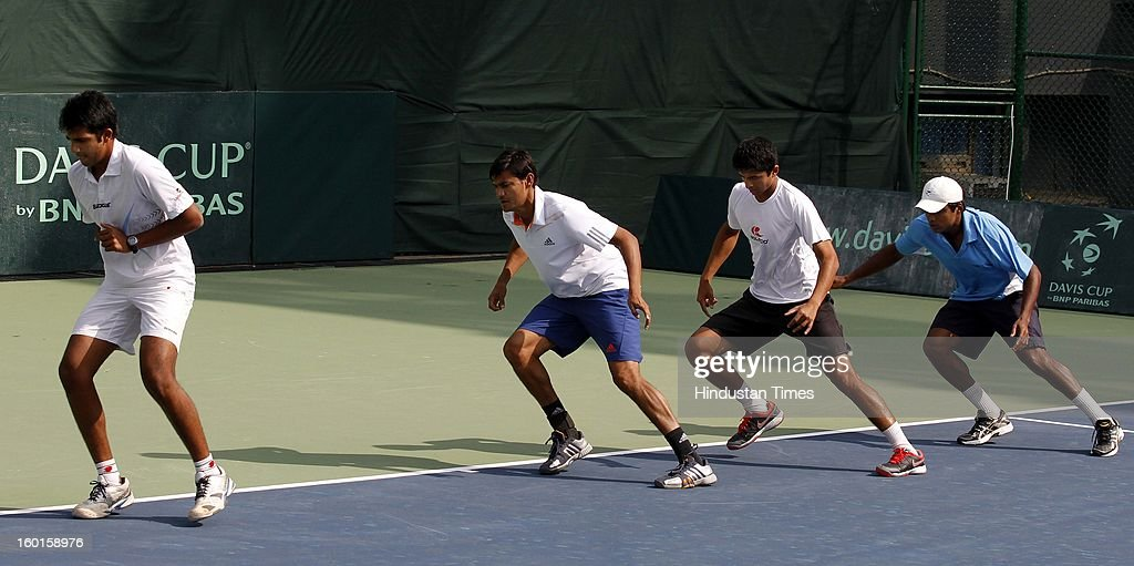Arjun Khare, Vijayant Malik, Ashwin Vijay Ragavan and V M Ranjeeth members of Indian Davis Cup team during practice session at Delhi Lawn Tennis Association on January 27, 2013 in New Delhi, India.