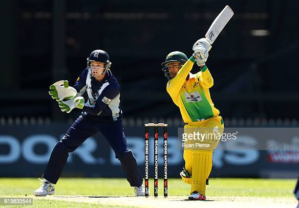 Arjun Nair of CA XI bats as Peter Handscomb of the Bushrangers keeps wicket during the Matador BBQs One Day Cup match between Victoria and the...