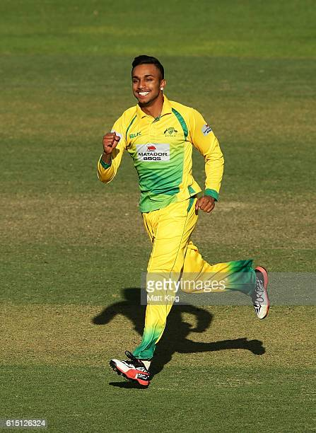 Arjun Nair of CA XI celebrates taking the wicket of Mitchell Marsh of the Warriors during the Matador BBQs One Day Cup match between the Cricket...