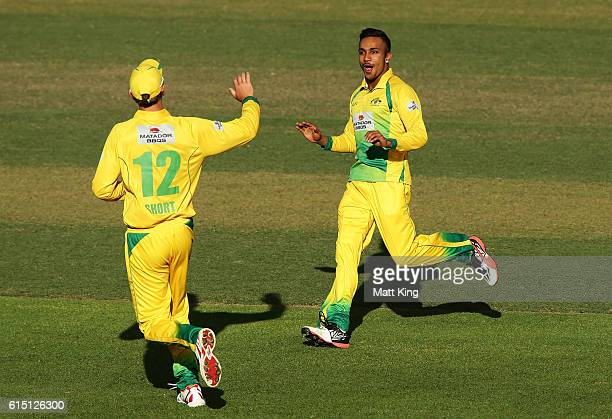 Arjun Nair of CA XI celebrates with team mates after taking the wicket of Mitchell Marsh of the Warriors during the Matador BBQs One Day Cup match...