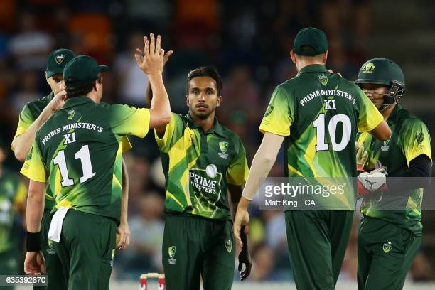 Arjun Nair of the Australian PMXI celebrates with team mates after taking the wicket of Niroshan Dickwella of Sri Lanka during the T20 warm up match...